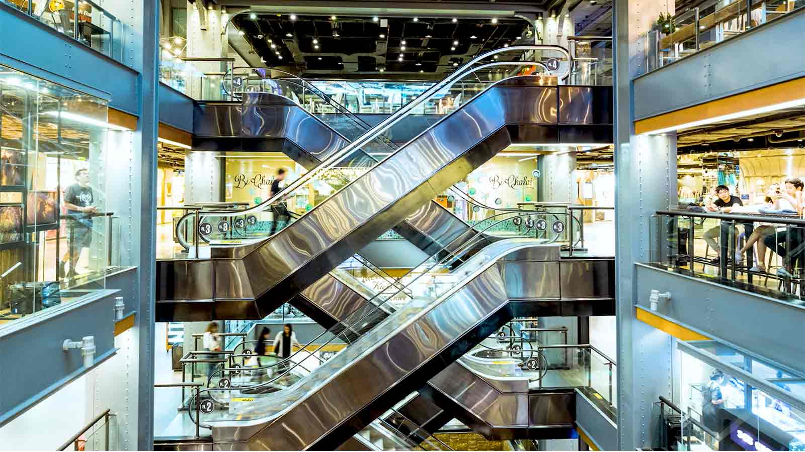 Modern escalators inside a building.